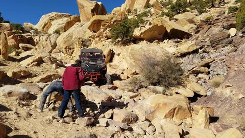 Rock crawling through dangerous mountain trail 4x4 4K Footage