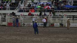 Rodeo rain storm cowboys ready at chutes 4K 268 Footage