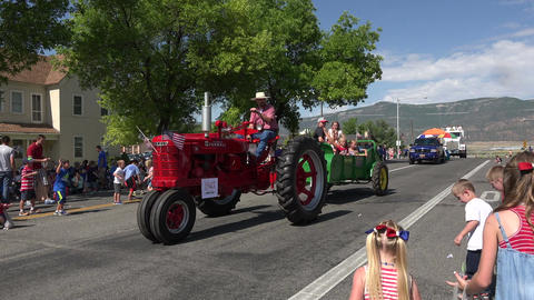 Rural community parade antique tractor candy kids 4K 231 Footage