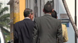 Business Men Walking On Sidewalk Footage
