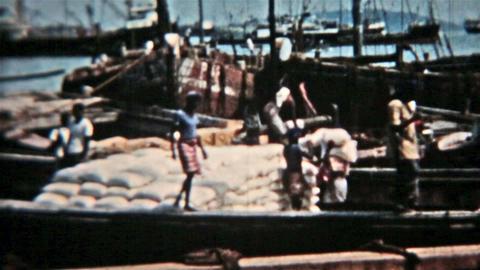 Thailand Circa 1960 vintage film men carry cargo off boat HD 0078 Footage
