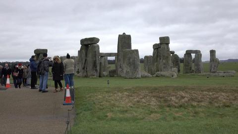 Tourist crowd Prehistoric Stonehenge monument Amesbury England 4K Footage