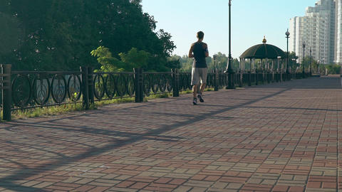 A guy in sportswear run on the track Footage