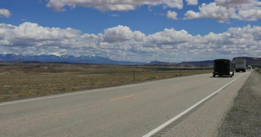 Traffic highway Moab Utah La Sal Mountains DCI 4K Footage