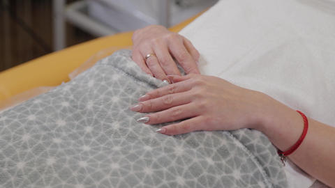 Beautiful hands of a girl in a beauty salon during the procedure Live Action