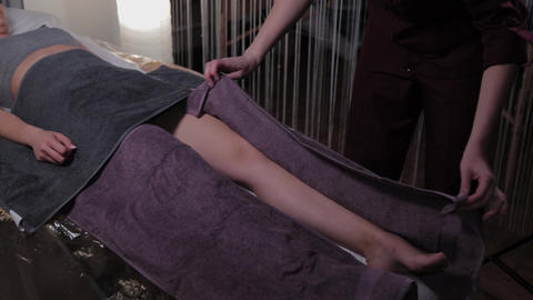 Beautiful woman cover with a towel in a beauty salon Live Action