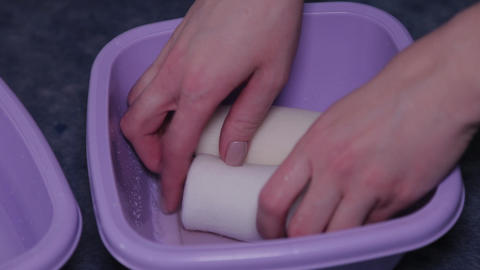 Female doctor wet a bandage in a special solution Live Action