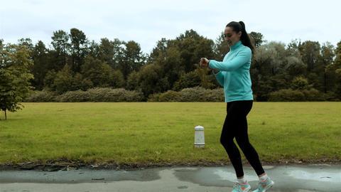 Woman runner using smart watch fitness smart watch Live Action