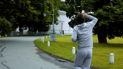 Jogger water from bottle splashing water Live Action