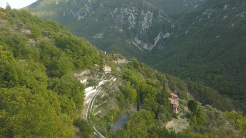 Mountain road surrounded by the green trees, beautiful mountain range, 4k Live Action