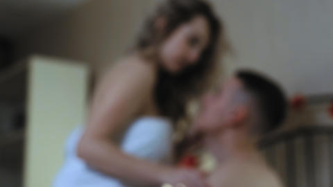 Defocused close-up A young couple in bed Live Action