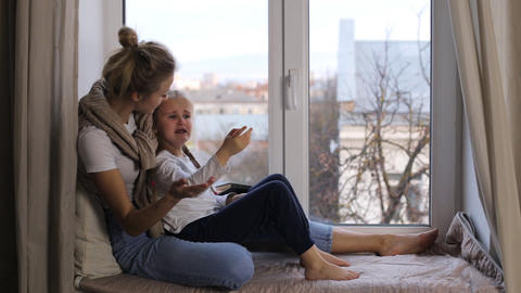 The little girl is crying, and her mother calms her Live Action