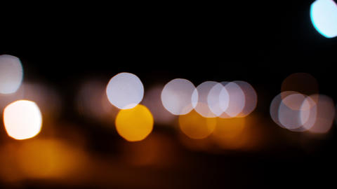 The city dissolves in the evening lights. Nocturne perspective of urban lights Live Action