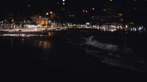 Night view of a small mediterranean coastal village. Night lights on the Live Action
