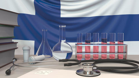 Clinic laboratory equipment on Finnish flag background. Healthcare and medical Live Action