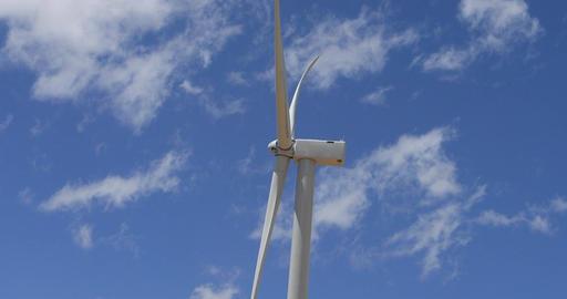 Windmill turbine turns side view beautiful cloud sky fast 4K Footage