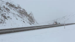 Winter snow blizzard traffic mountain highway Footage