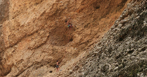 Woman climbs dangerous mountain cliff Utah DCI 4K Footage