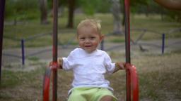 Child sway on teeter Footage
