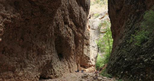 Woman rock climbing high mountain canyon cliff DCI 4K Footage