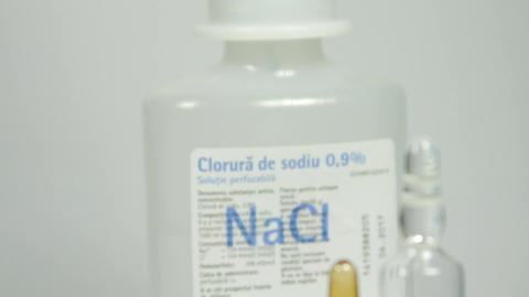 Medical Tray With Medicine, Vials And Syringe, Tilt Up Footage