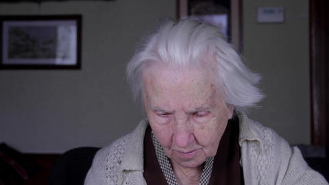 Portrait Of A 99 Years Old Woman Reading, Senescence, Old Age, Loneliness, Pan Footage
