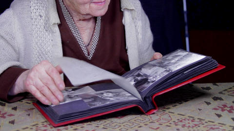 99 Years Old Woman Looking At A Photo In An Old Photo Album, Memories, Tilt Up Live Action