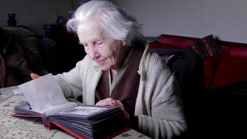99 Years Old Woman Looking At A Photo In An Old Photo Album, Memories, Nostalgia Live Action