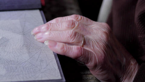 Close Up Of Very Old Woman Hands Flipping Through Photo Album Footage