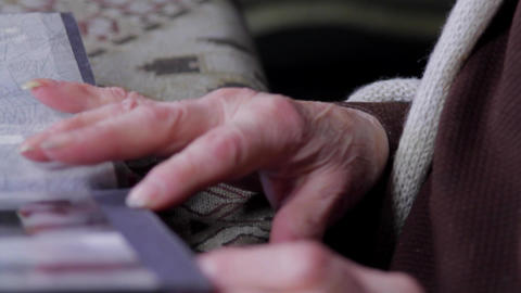 Close Up Of Very Old Woman Hands Flipping Through Photo Album, Tilt Down Footage