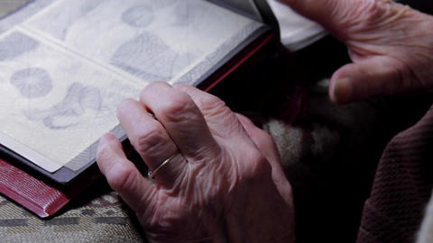 Very Old Woman Flipping Through Photo Album, Hands And Photos Detail Footage