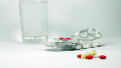 Rack Focus From Pills To Blisters And Glass Of Watter, Medication, Drugs Footage