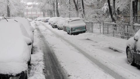 Street With Cars In Winter, Tire Marks In Snow, Blizzard, Winter, Tilt Down Footage