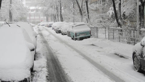 Street With Cars In Winter, Tire Marks In Snow, Blizzard, Winter, Pan Footage