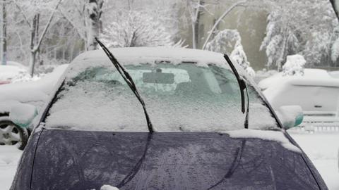 Frozen Car Windshield With Windshields Wipers Up in Blizzard, Still Shot Footage