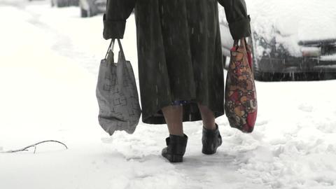 Old Woman Feet Walking Slow On A Narrow Path In Snow, City Street, Blizzard Footage