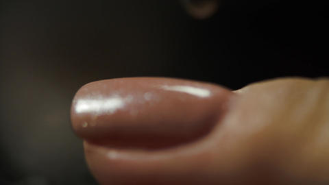 Young Woman Putting On A Second Layer Of Nail Polish ビデオ