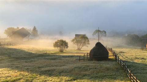 Beautiful landscape Romanian village foggy sunrise sunlight fog in Romania Live Action