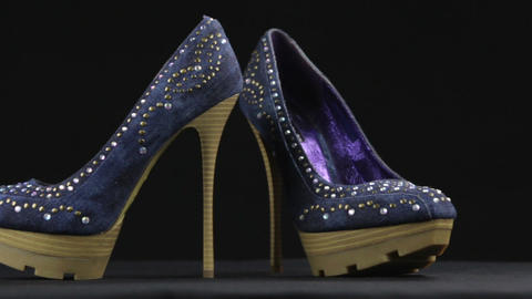 Close-up, a pair high-heeled shoes and platform in rhinestones. Slider shot Live Action