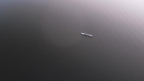 Drone shot aerial view scenic landscape of reservoir dam at the countryside, with fisherman and boat Acción en vivo