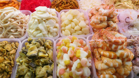Pickled vegetables and seafood on the store counter Live Action