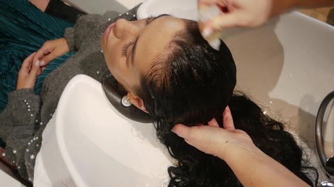 Hairdresser washes hair Live Action