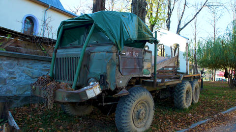 Old damaged truck in the village Live Action