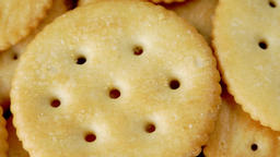 Golden round cheesy biscuit cracker close up stock footage Live Action