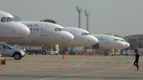 Airplanes parking at Siem Reap International Airport tarmac in the morning Live Action