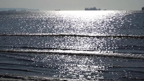 seascape with ships on the horizon Live Action