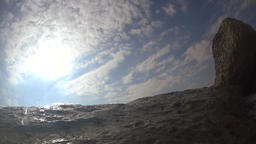 Waves rolling over the wavebreaker, slow motion Footage