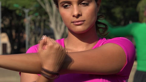 Fit Young Woman Stretching Her Arms Live Action