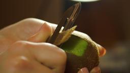 Woman Hands Peeling A Kiwi With A Peeler Footage