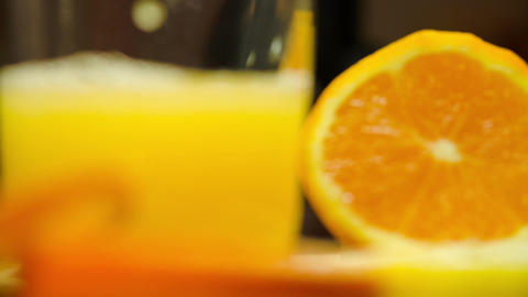 Glass Of Freshly Squeezed Oranges And Lemons Footage